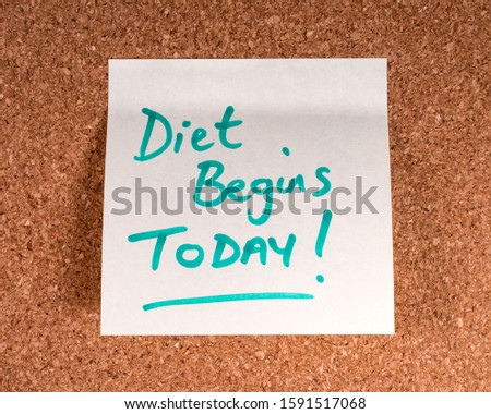 A Diet Begins Today! memo note stuck to a noticeboard. #1591517068
