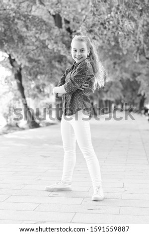 Fashion really makes her stand out. Fashion look of small vogue model. Adorable girl in fashion wear on summer day. Fashionable little child in casual fashion in park. #1591559887