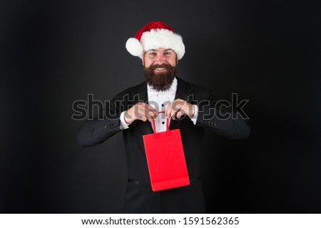 Very merry sale. Santa boss hold shopping bag. Happy businessman enjoy discount days. Happy holidays. Merry Christmas. Happy new year. Happy holiday season, copy space. #1591562365