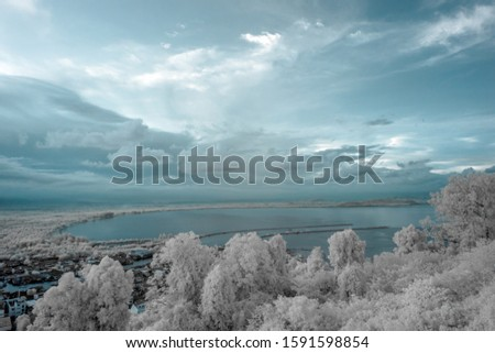 Aerial view of Chumphon city in provincial of Thailand taken from Mutsea view point  in infrared photography