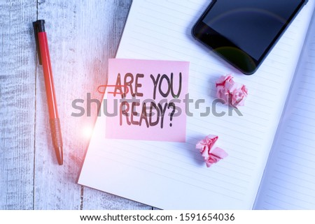 Text sign showing Are You Ready Question. Conceptual photo used telling someone start something when feel prepared Thick pages notebook stationary placed above classic look wooden backdrop. #1591654036