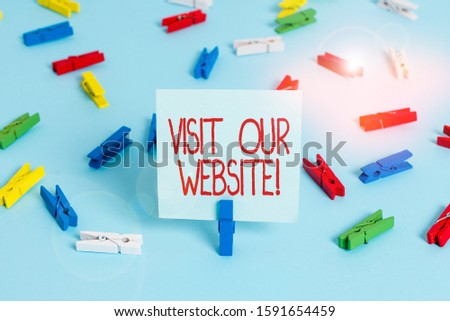 Writing note showing Visit Our Website. Business photo showcasing visitor who arrives at web site and proceeds to browse Colored clothespin papers empty reminder blue floor officepin. #1591654459
