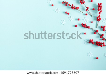 Christmas modern composition. Red berries on pastel blue background. Christmas, New Year, winter concept. Flat lay, top view, copy space #1591773607