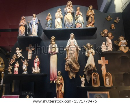 Wooden curved Mother Marry and Jesus Christ structures of various emotions at a souvenir shop of Austria.