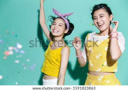 Two young woman isolated on background #1591823863