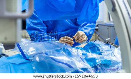 Operating process. Group of surgeons in clinic room with surgery equipment. Selective focus. Crop. Modern medical background. Closeup #1591844653