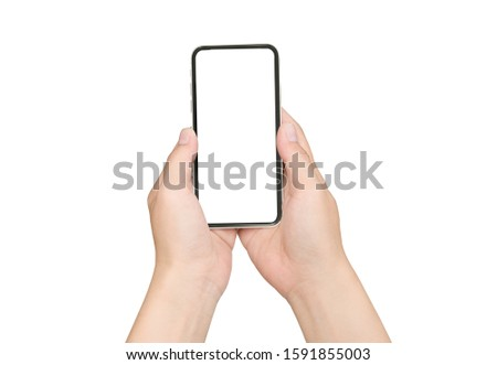 Female hand holding black cellphone with white screen at isolated background. #1591855003