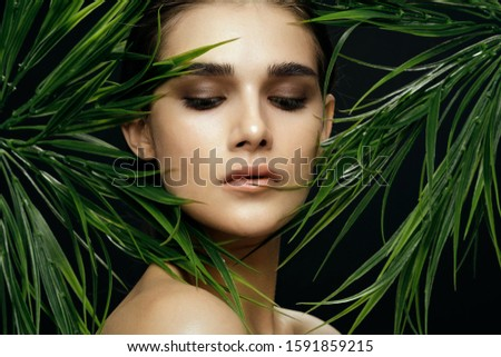 Beautiful woman green leaves jungle nature luxury #1591859215