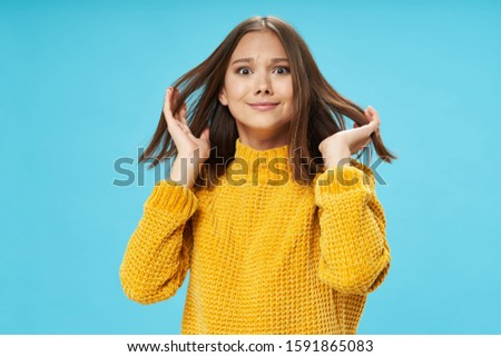 Cheerful woman joy studio blue background gesticulating with hands #1591865083