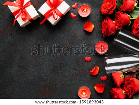 Valentines day romantic background - red roses, glasses, candle and hearts. Flat lay, copy space.  #1591893043
