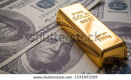 gold bar overlay  money dollars, Concept   In a poor economy Investors should hold dollar or gold. #1591893589