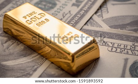 gold bar overlay  money dollars, Concept   In a poor economy Investors should hold dollar or gold. #1591893592