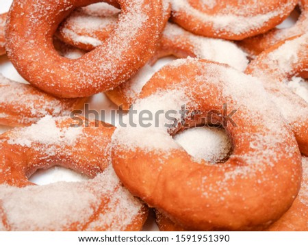 Handmade handmade donuts, traditional cuisine, and sugar sprinkled on top #1591951390