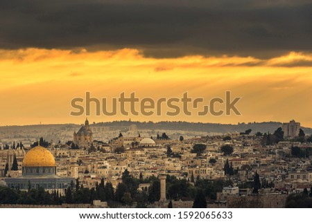 Dramatic Jerusalem Sunset, sun rays breaking through thick clouds over Jerusalem Old City #1592065633
