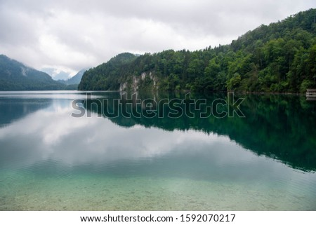 Beautiful mountain lake Alpsee - Hohenschwangau on a cloudy day, Germany #1592070217