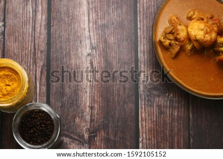 Flat lay of chicken curry and the food ingredient Delicious Asian food cuisine.  Asian food concepts picture. Turmeric, spices and black pepper.