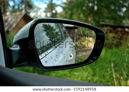 the reflection of nature in a car side mirror #1592148958