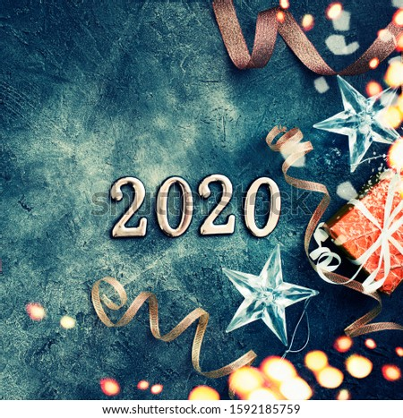 HAPPY NEW YEAR BACKGROUND WITH CHAMPAGNE ON DARK STONE WITH BOKEH  #1592185759