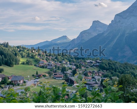 Alpine village on the border of France and Switzerland. Small alpine houses and alpine mountains #1592272663