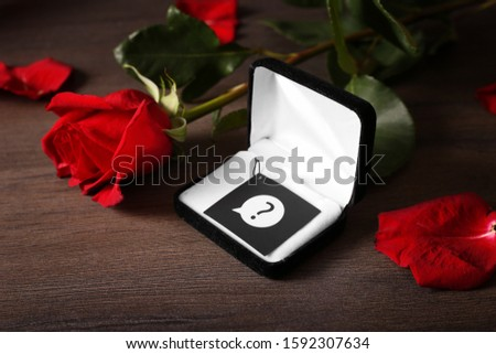 Waiting for proposal to get married. Will you marry me. Gift and flowers as a manifestation of love and feelings. Conceptual vision of creating a family. Why he does not call to marry.  #1592307634