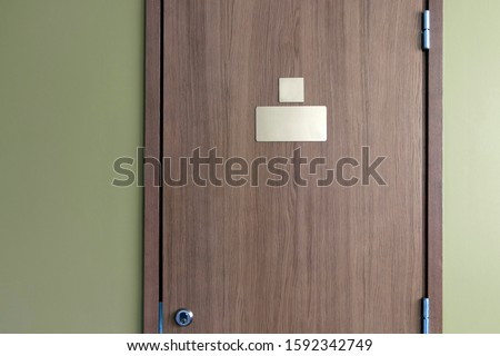 Clear nameplate on the door with lock. Room for text for name and number. Conceptual photo