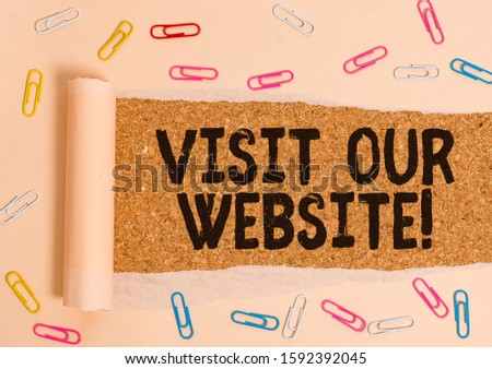 Word writing text Visit Our Website. Business concept for visitor who arrives at web site and proceeds to browse Paper clip and torn cardboard placed above a wooden classic table backdrop. #1592392045
