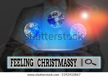 Writing note showing Feeling Christmassy. Business photo showcasing Resembling or having feelings of Christmas festivity Elements of this image furnished by NASA. #1592410867