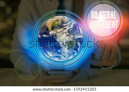 Writing note showing Bilateral Agreement. Business photo showcasing Legal obligations to nonbinding agreements of principle Elements of this image furnished by NASA. #1592411203
