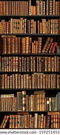 old books on wooden shelf #1592514526