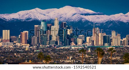 "FEBRUARY 6, 2019 - LOS ANGELES, CA, USA - ""City of Angeles"" - Los Angeles Skyline framed by San Bernadino Mountains and Mount Baldy with fresh snow from Kenneth Hahn State Park"
