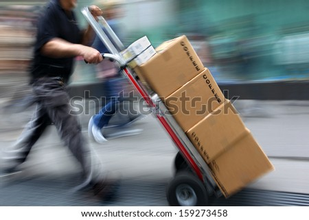 delivery goods with dolly by hand, purposely motion blur #159273458