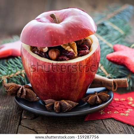 filled christmas apple with raisins and nuts   #159287756