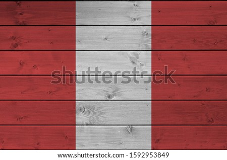 Peru flag depicted in bright paint colors on old wooden wall. Textured banner on rough background #1592953849