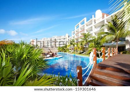 Swimming pool at caribbean resort. Exotic garden. Royalty-Free Stock Photo #159301646