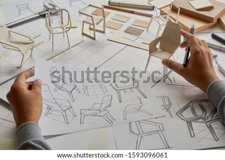 Designer sketching drawing design development product plan draft chair armchair Wingback Interior furniture prototype manufacturing production. designer studio concept .                            #1593096061