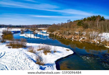 Winter rural river snow landscape. Forest river in winter snow. Winter river snow landscape #1593096484