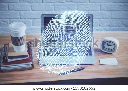 Computer on desktop in office with finger print drawing. Double exposure. Concept of business data security. #1593102652