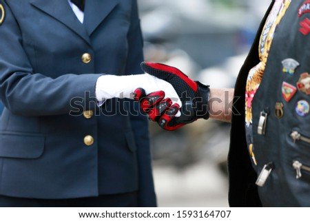 Handshake. Female hand in gloves and male. #1593164707
