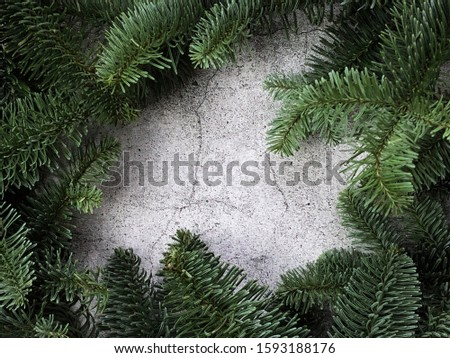 Winter christmas composition on gray concrete background. Frame of Christmas tree branches, gifts and toys. Festive background #1593188176