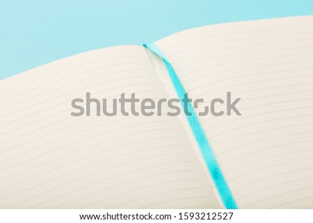 Open notebook, diary with blank and blank pages on a blue background, top view. #1593212527