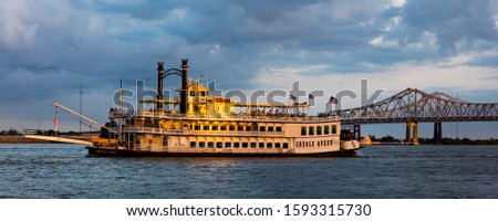 APRIL 24, 2019, NEW ORLEANS, LA, USA - Natchez Riverboat on Mississippi River in New Orleans, Louisiana at sunset #1593315730