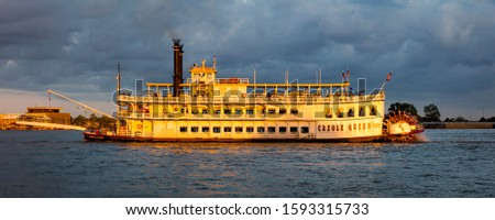 APRIL 24, 2019, NEW ORLEANS, LA, USA - Natchez Riverboat on Mississippi River in New Orleans, Louisiana at sunset #1593315733