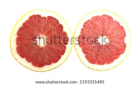 Two halves of grapefruit cut in half. #1593335485