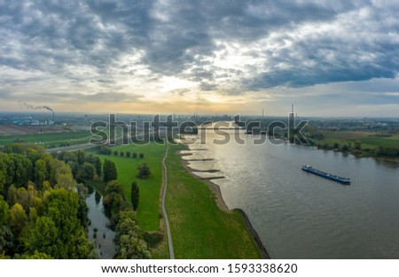Panoramic view on riverboats on the Rhine. Aerial photography by drone. #1593338620
