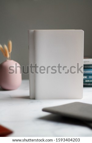 business background. notebooks white and grey. notebook in a cage on beautiful backgrounds. Close-up with blurred background. #1593404203