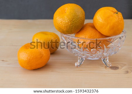 Clementines on wooden background. Clementine benefits for health concept. Holiday Concept #1593432376