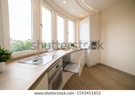 May 3, 2019. Uzhhorod city, Kitchen interior design. Modern apartment in bright colors and large panoramic window #1593451852