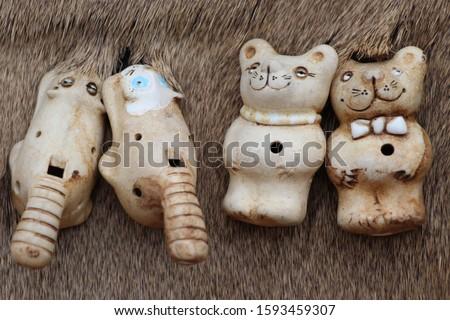 Clay handmade whistles. Clay bear Royalty-Free Stock Photo #1593459307