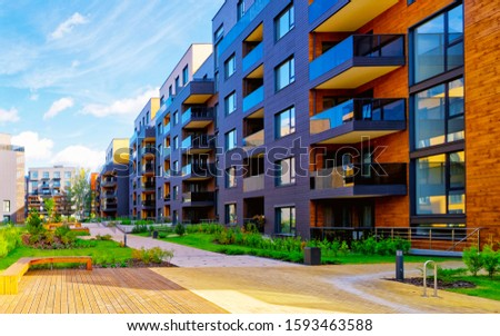 Apartment in residential building exterior. Housing structure at blue modern house of Europe. Rental home in city district on summer. Wall and glass high architecture for business property investment. #1593463588