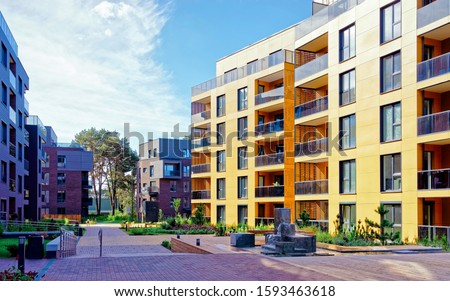 Apartment in residential building exterior. Housing structure at blue modern house of Europe. Rental home in city district on summer. Wall and glass high architecture for business property investment. #1593463618